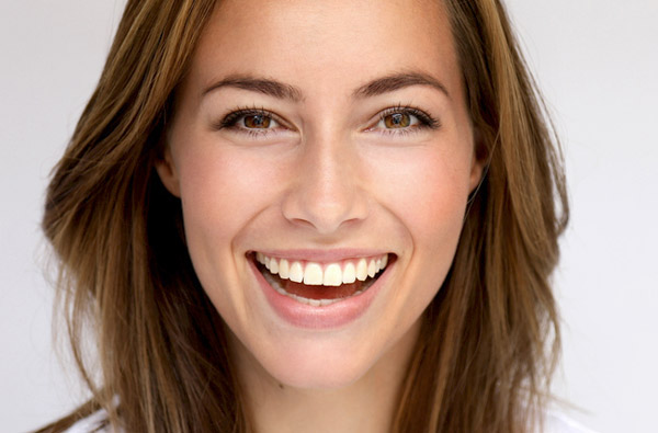 Beautiful woman smiling at Elite Dental of Natick in Natick, MA